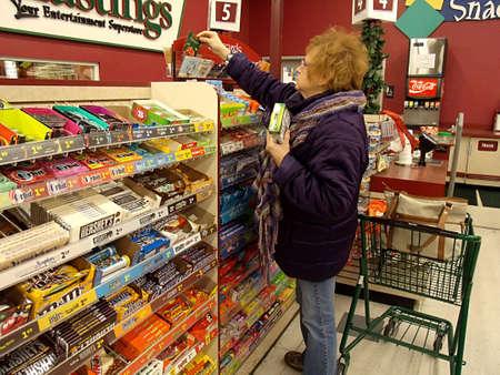 USA/IDAHO STATE/ LEWISTON _ Female christmas shopper at Hastings store 15 Dec. 2011  Stock Photo - 11521144