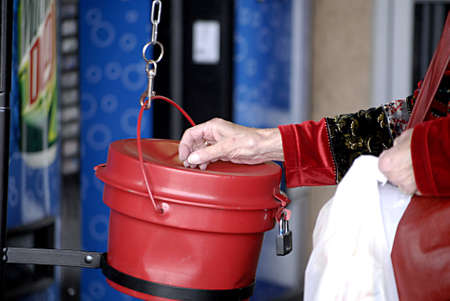 USA/WASHINTON STATE/ BONNY LAKE_Americen eldlery female donating money to Salvation army  doing the most good at christmasspirit at Walmart 24 Dec. 2011