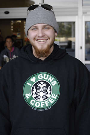 polictics: USAWASHINGTON STATE BONNEY LAKE_ Young american male with slogan I love guns and Coffee with starbucks symbol sign  24 Dec. 2011