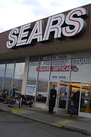 sears: USAIDAHO STATE LEWISTON _ Sears store in Lewiston sign show now hire though recording to media rreports that Sears is closing stores 28 Dec. 2011