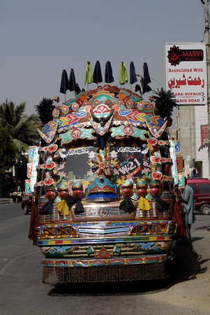 karachi: PAKISTAN  KARACHI _ Private bus transport system decorated with painting  texts  and flowers 24 Feb. 2012