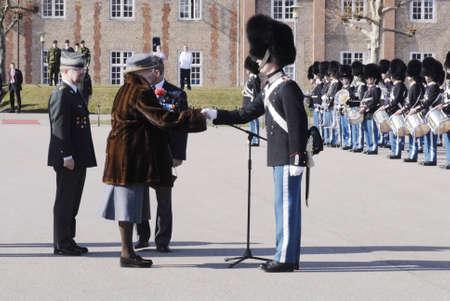 gaurd: COPENHAGENDENMARK _Royal life guards of Lars Oergaard Nielsen recives Queen Golden watch beacuse his service as royal guard queen lufe gaurd he is 22 and receies goden queen watch from HMthe Queen Margrethe II today on March 14.  2012
