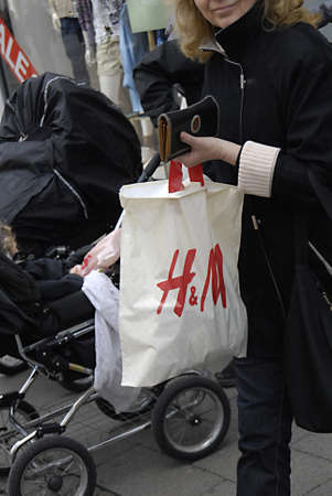 hm: COPENHAGENDENMARK _ H&M Swedish fqashion retailer chain could target older market recording to Financial Times report,Sundays consumer with H&M shopping bagds today on sunday 2 April 2012