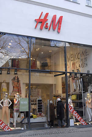 COPENHAGEN/DENMARK _ H&M Swedish fqashion retailer chain could target older market recording to Financial Times report,Sunday's consumer with H&M shopping bagds today on sunday 2 April 2012        Stock Photo - 12993974