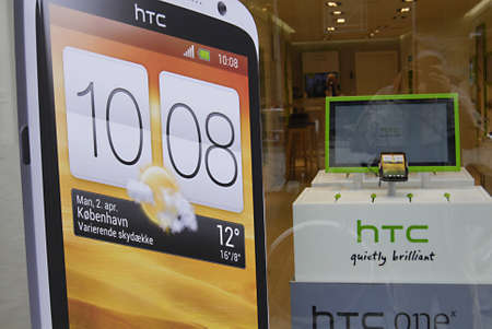 htc: COPENHAGENDENMARK _Consumers entering in Htc smart phonee and other nitem store on kobermagergade 18 April 2012