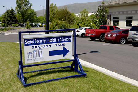 CLARKSTONWASHINGTON STATE USA _  Sign of Social Security Disbality Advocacy  Public Counciling group building 15 May 2012