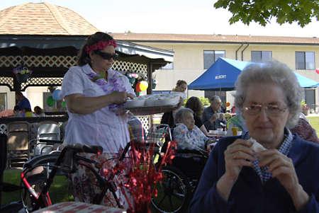 LEWISTON/IDAHO STATE/USA _ Senior citizen at R oyal Plaza Retirement Center  enjoy barbeque hawaiian day hotdogs and hamburgers and classic car show today on thursday 16 May 2012       Stock Photo - 13685308