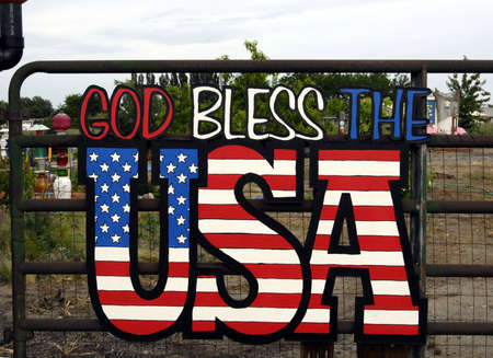 god bless: BURBANKWASHINGTON STATE USA _American orchard   flowers watering can slogans God bless USA and proud to be american 29 May 2012