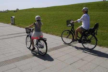 the bather: KASTRUPCOPENHAGENDENMARK _Life at Amager Park beach Kastrup, sun bather bikers,sun bath watcher swimers  danish summer heat 90 F in sun enjoy sun at Amager beach today on sunday 8 July 2012         Editorial