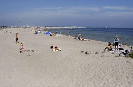 the bather: KASTRUPCOPENHAGENDENMARK _Life at Amager Park beach Kastrup, sun bather bikers,sun bath watcher swimers  danish summer heat 90 F in sun enjoy sun at Amager beach today on sunday 8 July 2012