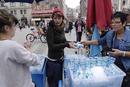 immigrants: COPENHAGENDENMARK _  Tow polish female immigrants works as water vendors among tourists pedestrain street today on saturday 21 JUly 2012
