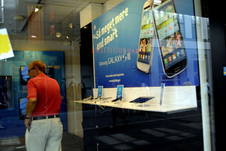 COPENHAGEN/DENMARK _   New Samsung Galaxy III smartphone on sale at telia swedish telephone shop 2 August 2012       Stock Photo - 14681857