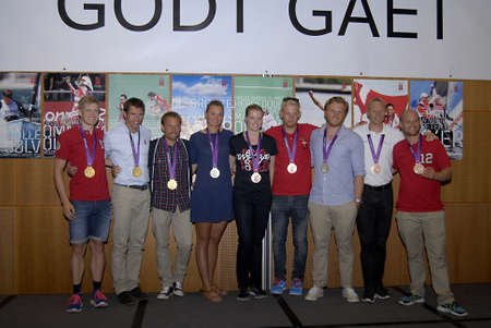 ondon: COPENHAGENDENMARK LKond Ol 2012 _ Three danish gold medalist  in red shirt(L) Lasse Norman HGansen god medal in cycling  (C) in light blud eshirt Mads Renholdt and (R) Rasmus Quist gold medalist in double culler welcome recpection with other other silver Editorial