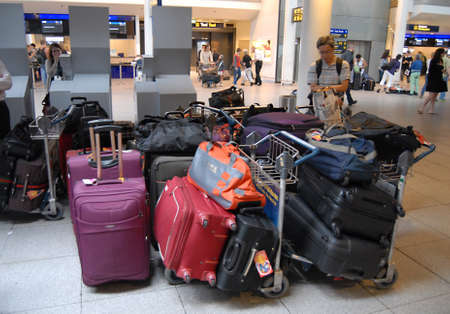 kastrup: KASTRUPCOPENHAGENDENMARK _ Travel and tourism travelers journey with metro computer train tto Kastrup Copenhagen International Airport tdoay and plenty of luggage at airport today on saturday 25 August 2012           Editorial