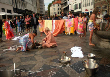 constitutes: COPENHAGENDENMARK _  what constitutes a community The comunity cycle birth,life ,death and after life artists performing at Amager torv on stroget today as part of Copenhagen art festival 26 August 2012          Editorial