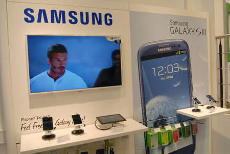 COPENHAGENDENMARK _  Both american Ipahone 4 smartphone and South korean Samsung Galaxy SIII do sell in Copenahgen by TDC Teledanmark cabple stores in Copenhagen Denmark27 August 2012      Editorial