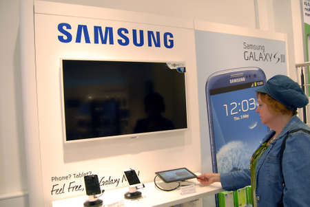 COPENHAGENDENMARK _  Both american Ipahone 4 smartphone and South korean Samsung Galaxy SIII do sell in Copenahgen by TDC Teledanmark cabple stores in Copenhagen Denmark27 August 2012