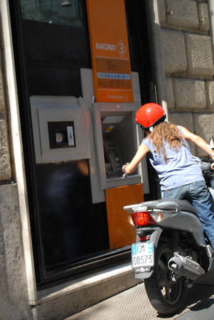 cashing: ROME  ITALY _ Local and travelers cashing money from money automatic machines today rome 31 August 2012          Editorial