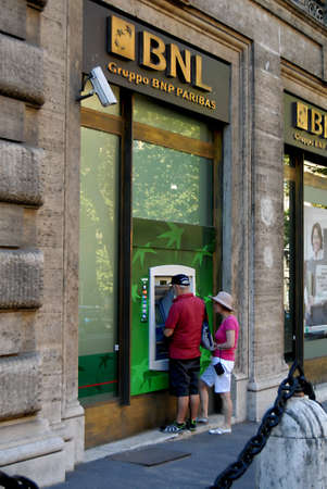 cashing: ROME  ITALY _ Local and travelers cashing money from money automatic machines today rome 31 August 2012