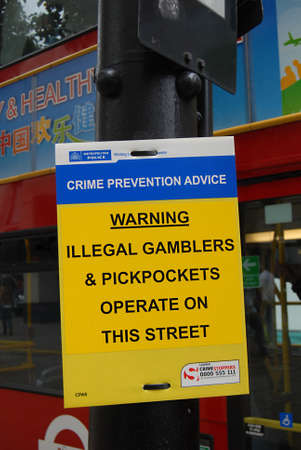 LONDON/ ENGLAND /UK _ Warning crime prevention advice ileegal gamblers and pickpockets operate pm this street (oxford street) 10 Sept. 2012        Stock Photo - 15180887