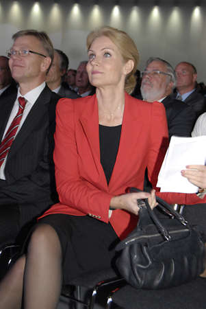 be the change: COPENHAGENDENMARK _Be The Change- Denmarks female prime minister Ms.Helle Thorning-Scmidt,( in red dress) social democrat and collection government arrives and been asked TV and media people about her visit to DITOP MEETING2012 ,Danish industryannaul m