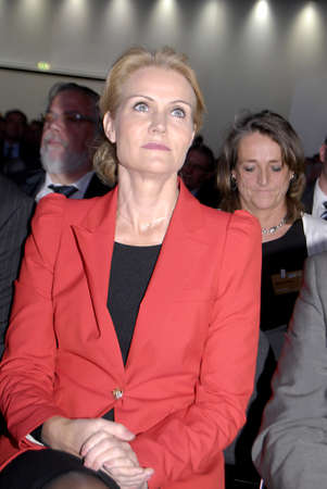 helle thorning schmidt: COPENHAGENDENMARK _Be The Change- Denmarks female prime minister Ms.Helle Thorning-Scmidt,( in red dress) social democrat and collection government arrives and been asked TV and media people about her visit to DITOP MEETING2012 ,Danish industryannaul m