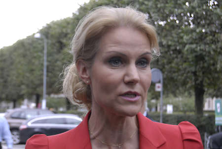 COPENHAGEN/DENMARK _Be The Change- Denmark's female prime minister Ms.Helle Thorning-Scmidt,( in red dress) social democrat and collection government arrives and been asked TV and media people about her visit to DITOP MEETING2012 ,Danish industry'annaul m Stock Photo - 15453269