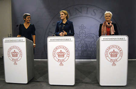 mirro: COPENHAGENDENMARK _ Ms.Helle Thorning-Schmidt danish prime minieter in blue cneter holds Press meeting with Ms.Margrethe Vestager Minister for Economy and  minister for home affairs  from Radical liberal party  and newly elected SF chairwoman  and new Mi