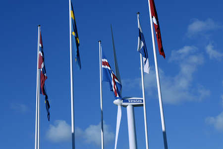 vestas: COPENHAGENDENMARK _nordic and eu flags and  Vestas turbine gives enhough pwer to light whole Bella Center 28 Oct. 2012