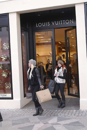 louis vuitton: Copenhagen  Denmark.  Shoppers shopping at Louis Vuitton luxury store at amager torv today 30 Oct. 2012