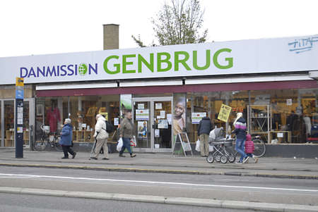 ngo: Copenhagen  Denmark.   NGO Danmission 2ndhand shop and people work a valunteers with pay on Jusum torv  2 Nov 2012