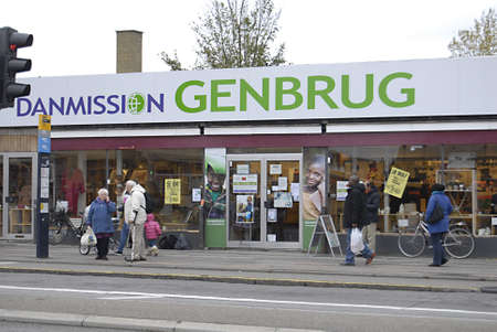 ediroial: Copenhagen  Denmark.   NGO Danmission 2ndhand shop and people work a valunteers with pay on Jusum torv  2 Nov 2012