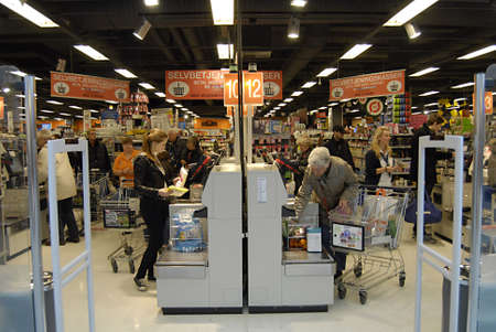 fakta: Copenhagen  Denmark._Danes self checking payment machine in Fakta like in usa store  2 Nov. 2012