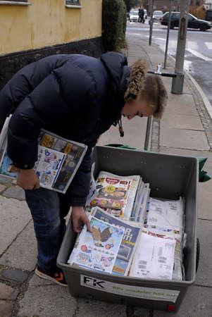 ediroial: Copenhagen  Denmark. Danish teen student make 50 danish korner per hour distributing free newspaper and cmmercial along with newspaper about less then 200 papers 3 Nov. 2012    Editorial