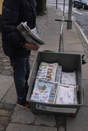 distributing: Copenhagen  Denmark. Danish teen student make 50 danish korner per hour distributing free newspaper and cmmercial along with newspaper about less then 200 papers 3 Nov. 2012