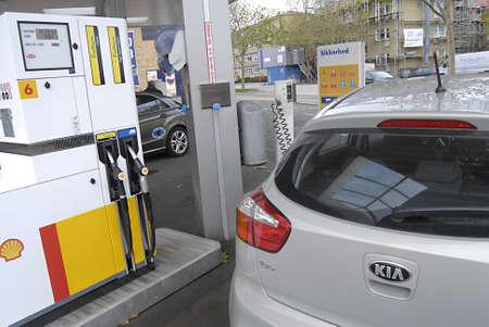 ediroial: Copenhagen  Denmark. Male pumping Shee Duel save Diesel in new Kia auto 7 Nov 2012        Editorial