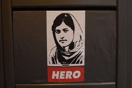 ediroial: Copenhagen  Denmark.   Pakistani student activiest Malala Yousufzai who was shot in Pakistan by Taliban in swat vally now been treated in Uk as Heo and hopes on T.shirt on sale today 7 Nov. 2012    Editorial