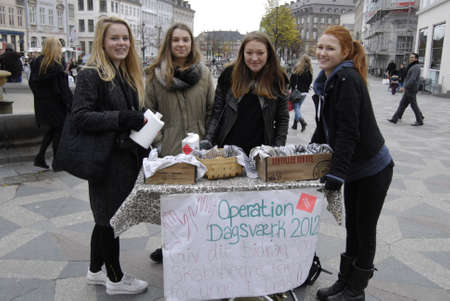 iraq money: Copenhagen  Denmark. danish school students give one school day to sell cakes and coffe to collect money for Iraq school childrren,call one day school give to workshop and some student do not bothers and like to spend day on strtee to collect donation th