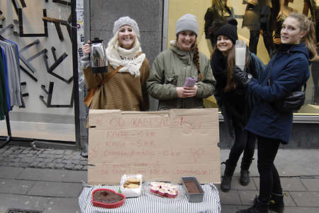 ediroial: Copenhagen  Denmark. danish school students give one school day to sell cakes and coffe to collect money for Iraq school childrren,call one day school give to workshop and some student do not bothers and like to spend day on strtee to collect donation th