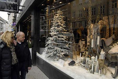ediroial: Copenhagen  Denmark.  Early christmas decorations on various store even on vendors selling christmas decorations and christmas decorating Illum Bolighus  on stroeget 9 Nov. 2012