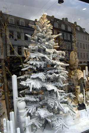 ediroial: Copenhagen  Denmark.  Early christmas decorations on various store even on vendors selling christmas decorations and christmas decorating Illum Bolighus  on stroeget 9 Nov. 2012         Editorial