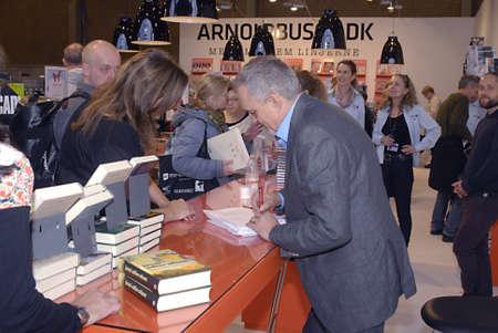 ediroial: Copenhagen  Denmark. Jussi Adler-Olsen author and writer signs his new book Journal 64,at Book fair 2012 (Bogmessen 2012)in Bella Center  his previous best seller   10 Nov. 2012