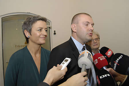 ediroial: Copenhagen  Denmark.  Danish government Finance minister Bjarn Corydon center ms.Margrethe Vestager miister for Economy  and home home minister at right  in picture and Holger K.Nielsen minister tax and revenue talking to press media state agreement with