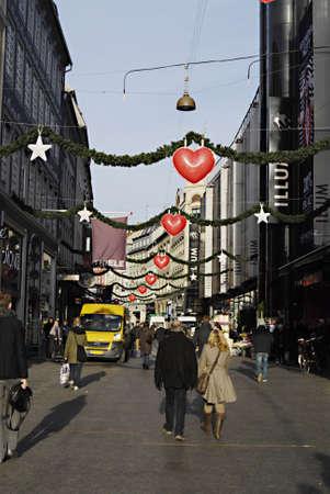ediroial: Copenhagen  Denmark.  Christmas shoppers with shoppig bags 23 Nov. 2012