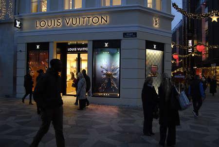 ediroial: Copenhagen  Denmark.  christmas shopper around Louis Vuitton luxary store 27 Nov. 2012