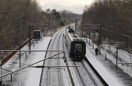 ediroial: kokkedal  Denmark. Train passing in snow falls    1 dec.2012