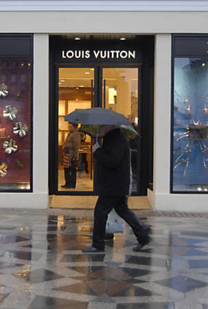 louis vuitton: Copenhagen  Denmark. Christmas shoppers in rainyweather at stroeget passing by Louis Vuitton luxury store and Georg Jensen danish sliver smith store now Georg Jensen is own by Mideast investor from Bahrain today on 4 December 2012   Editorial