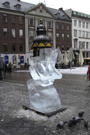ediroial: Copenhagen  Denmark._Children looking at unname artists Ice Sculturre at Gl.torv on stroeget today on 5th Dec. 2012