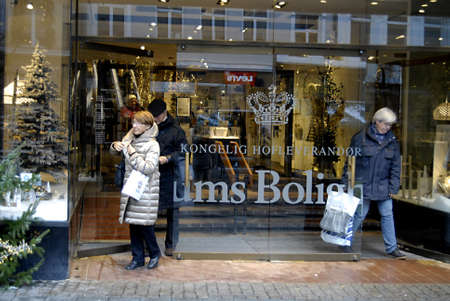 ediroial: Copenhagen  Denmark. Christmas shoppers with various christmas shopping bags danes still buying christmas shopping for millions of danish kroner though financial crisis in denmark 5 Dec. 2012