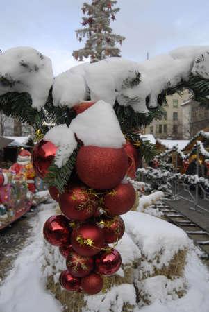 ediroial: Copenhagen   Denmark   Snow falls on christmas trees and Ornament  during cold snow falls weather 11 Dec  2012       Stock Photo